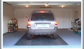 put a rubber mat under your car to protect your garage floor