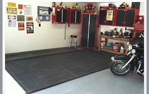 put a rubber mat under your motorcycle to protect your garage floor